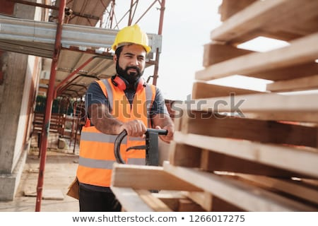 Latino Manual Worker With Forkift Pallet Stacker In Construction Site Stock photo © diego_cervo