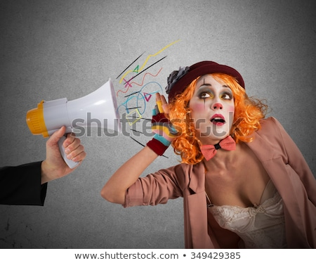 Funny clown hears a megaphone with a message Stock photo © alphaspirit