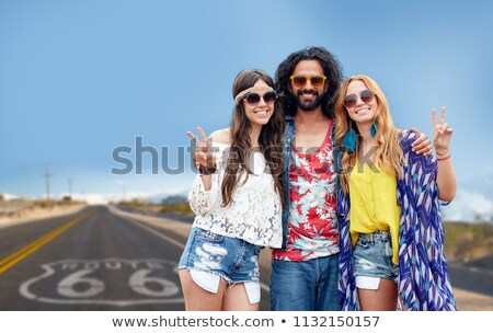 hippie friends showing peace over us route 66 Stock photo © dolgachov