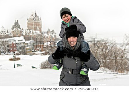 Mother and Son on his shoulder In Snowy Landscape Stock photo © Lopolo