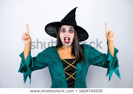 Donna strega punta copia spazio sorridere Foto d'archivio © deandrobot