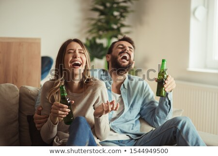 male alcoholic with bottle of beer at home Stock photo © dolgachov