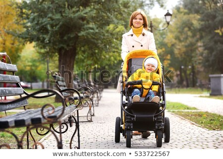 People Walking in Autumn Park with Perambulator Stock photo © robuart