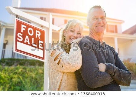 Attractive Middle-aged Couple In Front House and Sold Real Estat Stockfoto © feverpitch