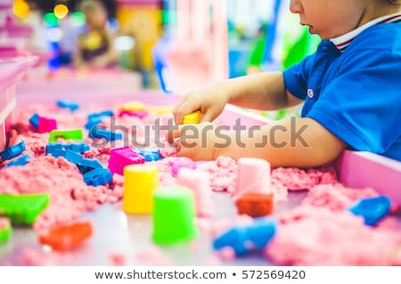 Foto stock: Boy playing with sand in preschool. The development of fine motor concept. Creativity Game concept