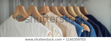 Clothes on hangers in the cabinet gradient from white to dark blue Zdjęcia stock © galitskaya