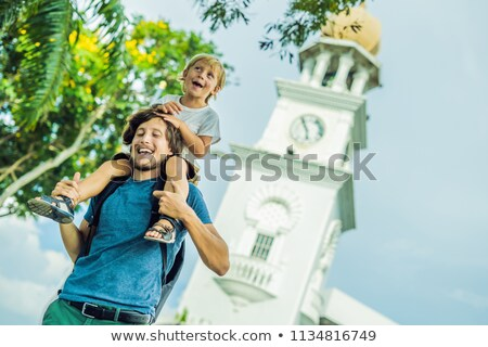 Father and son of tourists in the background of Queen Victoria Memorial clock tower, Penang Foto stock © galitskaya