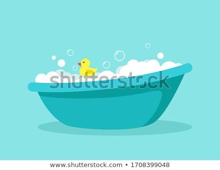 ストックフォト: Baby with Duck in Soap Water and Kids Care Objects