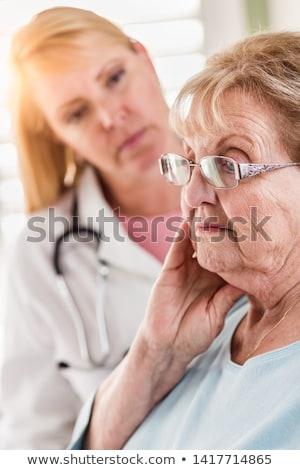Melankoli kıdemli yetişkin kadın kadın doktor Stok fotoğraf © feverpitch
