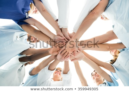 Directly Below Shot Of Doctor Stacking Hands Together Stock photo © AndreyPopov