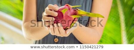 Sárkány gyümölcs gyönyörű női kezek zöld Stock fotó © galitskaya