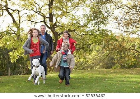 Сток-фото: молодые · семьи · улице · ходьбе · парка · собака