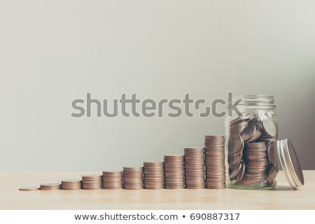 Stacking coins and money growing for saving, Coin in glass bottl Stock photo © Freedomz