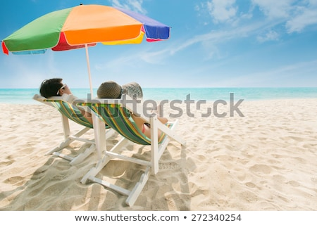 Сток-фото: Young Woman On The Beach In A Hat And Beach Umbrella
