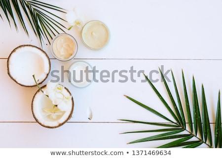 Stok fotoğraf: Hindistan · cevizi · yağ · kozmetik · yaprakları · beyaz · ahşap