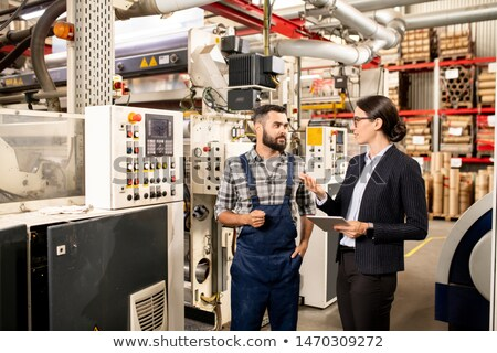 Two young business partners discussing working methods of industrial production Stock photo © pressmaster