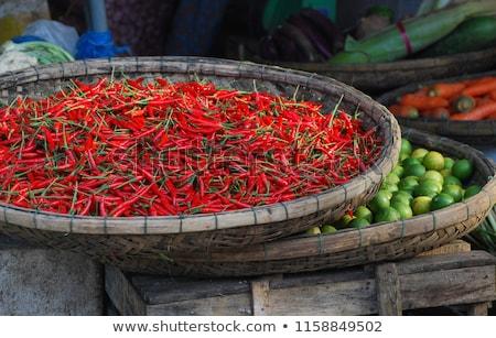 Fresh greens in the wicker basket on the Vietnamese market Stock photo © galitskaya