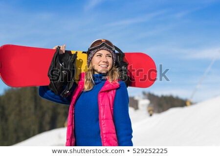 Girl with a snowboard on a snowy slope. Stock photo © ConceptCafe