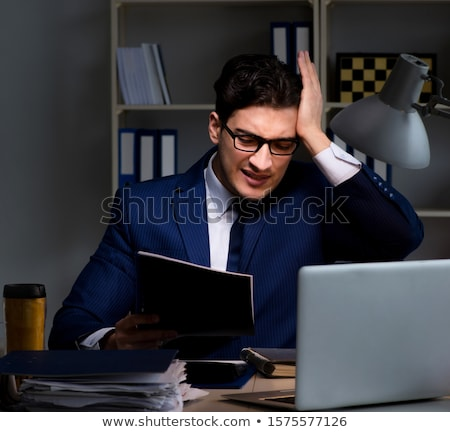 Employee working late to finish important deliverable task Stock photo © Elnur
