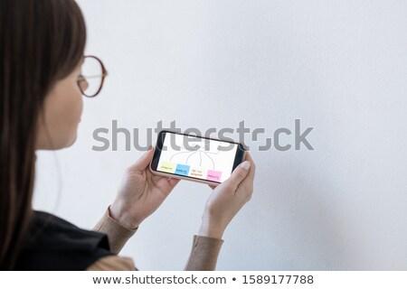 Mains Homme coach smartphone prise de décision Photo stock © pressmaster
