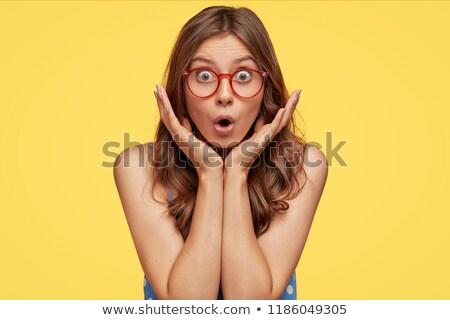 Bać młoda kobieta okulary ludzi żółty Zdjęcia stock © dolgachov