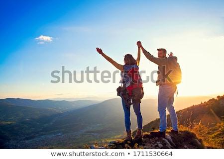 Tourist on rock Stock photo © orla