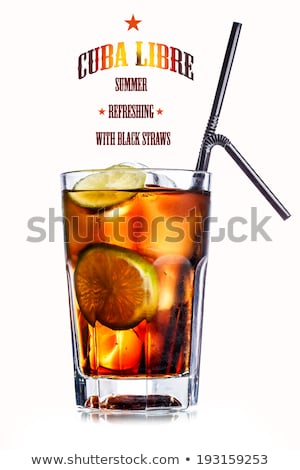 Cuba Libre Cocktail in highball glass with ice cubes and slice of lime with black straw on white. Stock photo © DenisMArt