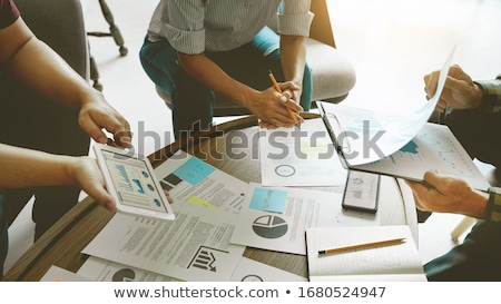 Business people meeting at office writing memos on sticky notes. Stock photo © snowing
