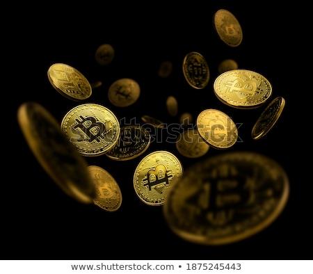 Gold coin Bitcoin levitates on a black background Stock photo © butenkow