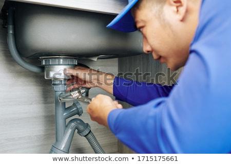 Tesisatçı çalışmak üniforma görüntü yakışıklı Stok fotoğraf © deandrobot