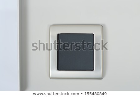 Light Switch On The Wall With Grey Button On Silver Frame Foto stock © tarczas