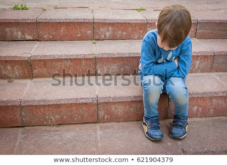 sad , unhappy, lonely grieving, child kid or boy Stock photo © godfer