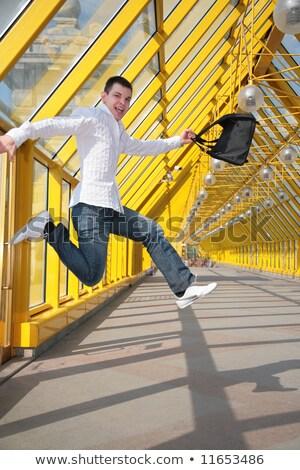 молодым человеком сумку пешеходный мост счастливым стекла время Сток-фото © Paha_L