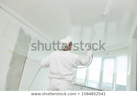 Painter spray painting Stock photo © Trigem4
