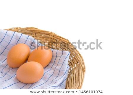 Three Brown Eggs in Rattan Basket stock photo © azamshah72