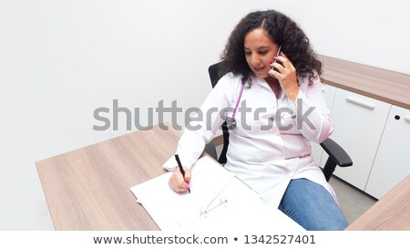 businesswoman in a hospital talking on her cell Stock photo © photography33