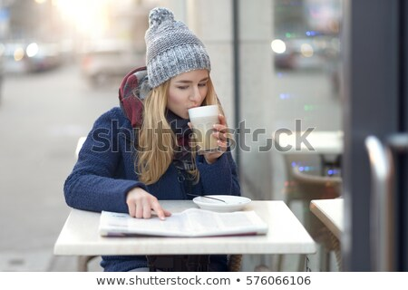 happy young woman with latte macchiato coffee and a newspaper stock photo © rob_stark