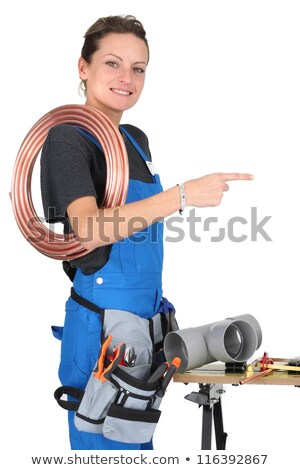 female apprentice plumber sawing copper pipe stock photo © photography33