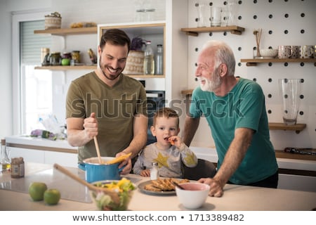 Parents preparing breakfast for children Stock photo © photography33