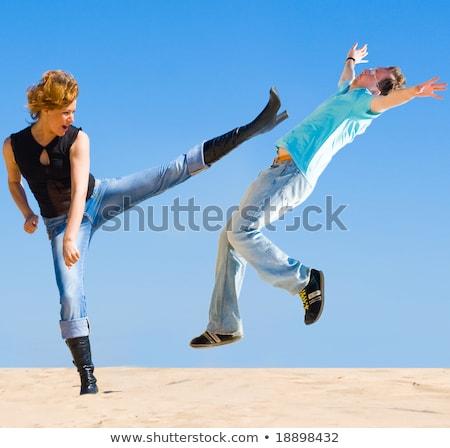 black woman kicking man stock photo © piedmontphoto