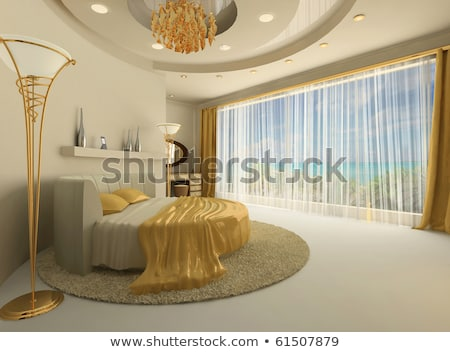 Stock photo: round bed in a luxurious bedroom with a suspended ceiling