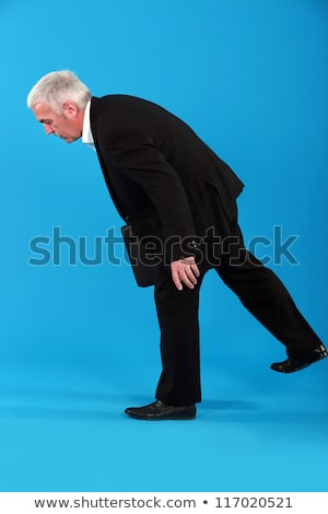 Old businessman struggling to stay in his feet Stock photo © photography33