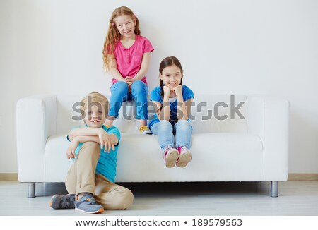 Three smiling lads sitting on a sofa Stock photo © photography33
