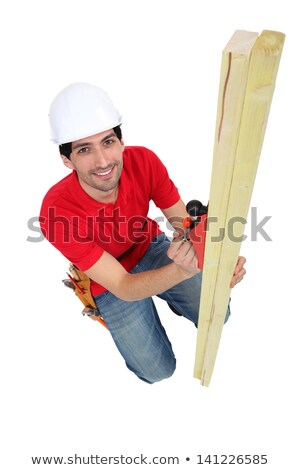 tradesman using a plane to smooth a plank of wood stock photo © photography33
