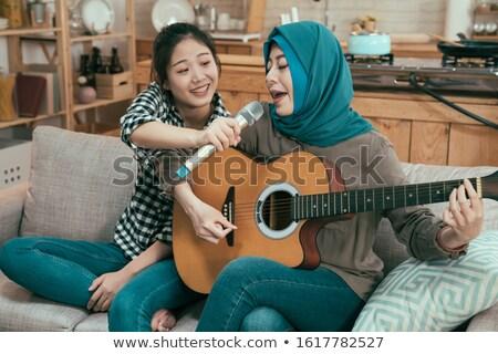 два человека пения играет гитаре девушки человека Сток-фото © photography33