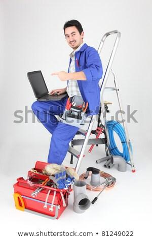 Man vergadering ladder laptop sanitair tools Stockfoto © photography33