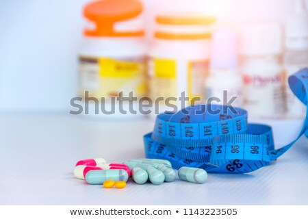Weight Loss Medicine Capsule Pill Medical Diet Supplement Stock photo © iqoncept