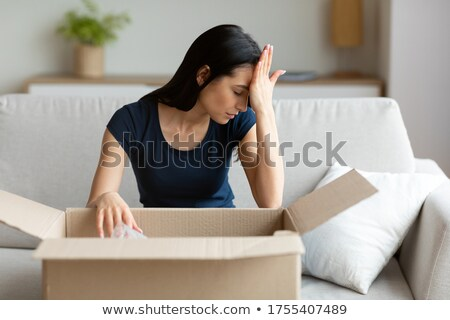Sad brunette with box Stock photo © photography33