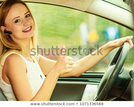 Woman talking on her mobile phone in her car Stock photo © photography33