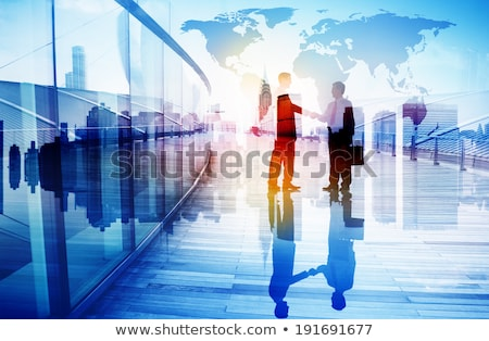 Internationale bedrijfsleven deal handdruk twee Blauw wereldkaart Stockfoto © Lightsource